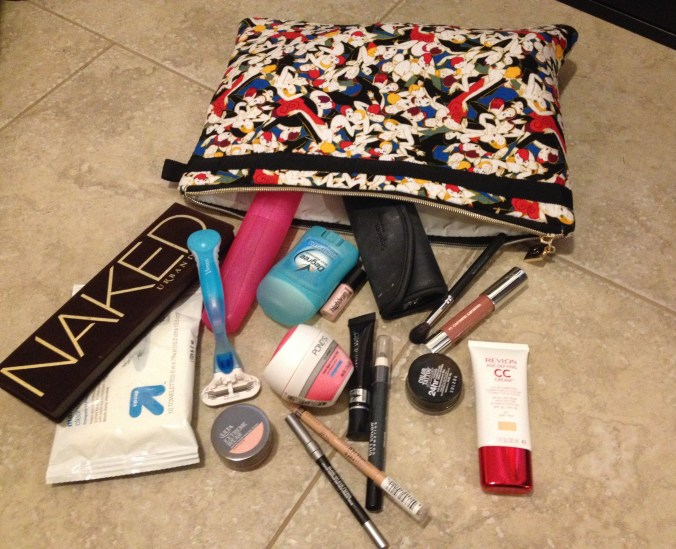 It may not look like it, but believe me this is minimalist makeup packing for me.