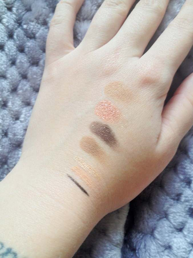 Swatches from Top to Bottom: NYX's Velvet, ColourPop's Sequin, Silly from the Nude 'tude palette, Seductive from the Nude 'tude palette, Stila's Kitten, Rimmel's ScandalEyes liner in Nude, and Jesse's Girl eye liner